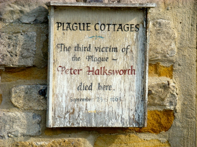 Sign for the Plague Cottages - The third victim of the Plague Peter Halksworth died here.