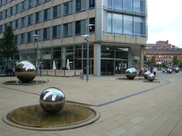 Steel balls with flowing water public art in Sheffield