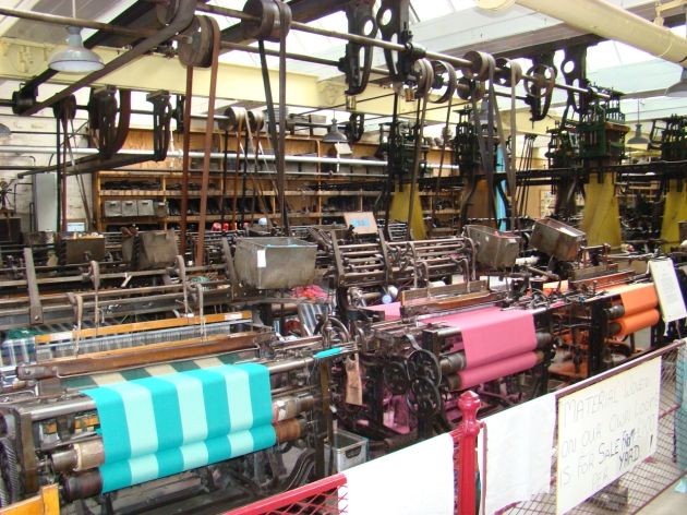 Lancashire and Yorkshire looms, weaving traditional cloth.