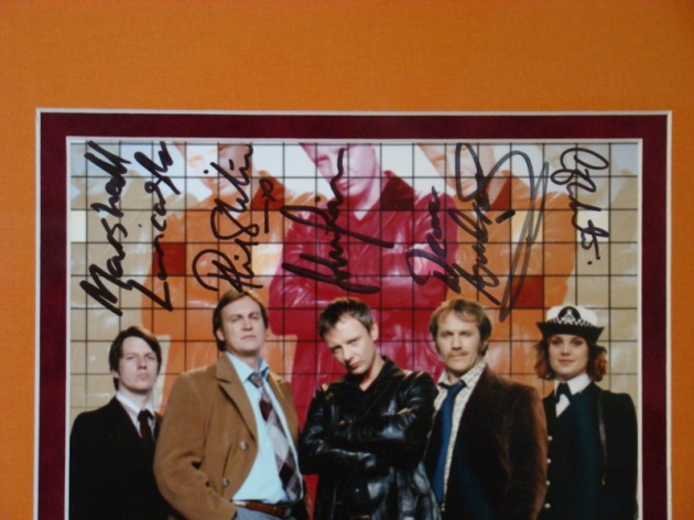 Autograph Detail:  One of a kind Life On Mars photo signed by the Cast